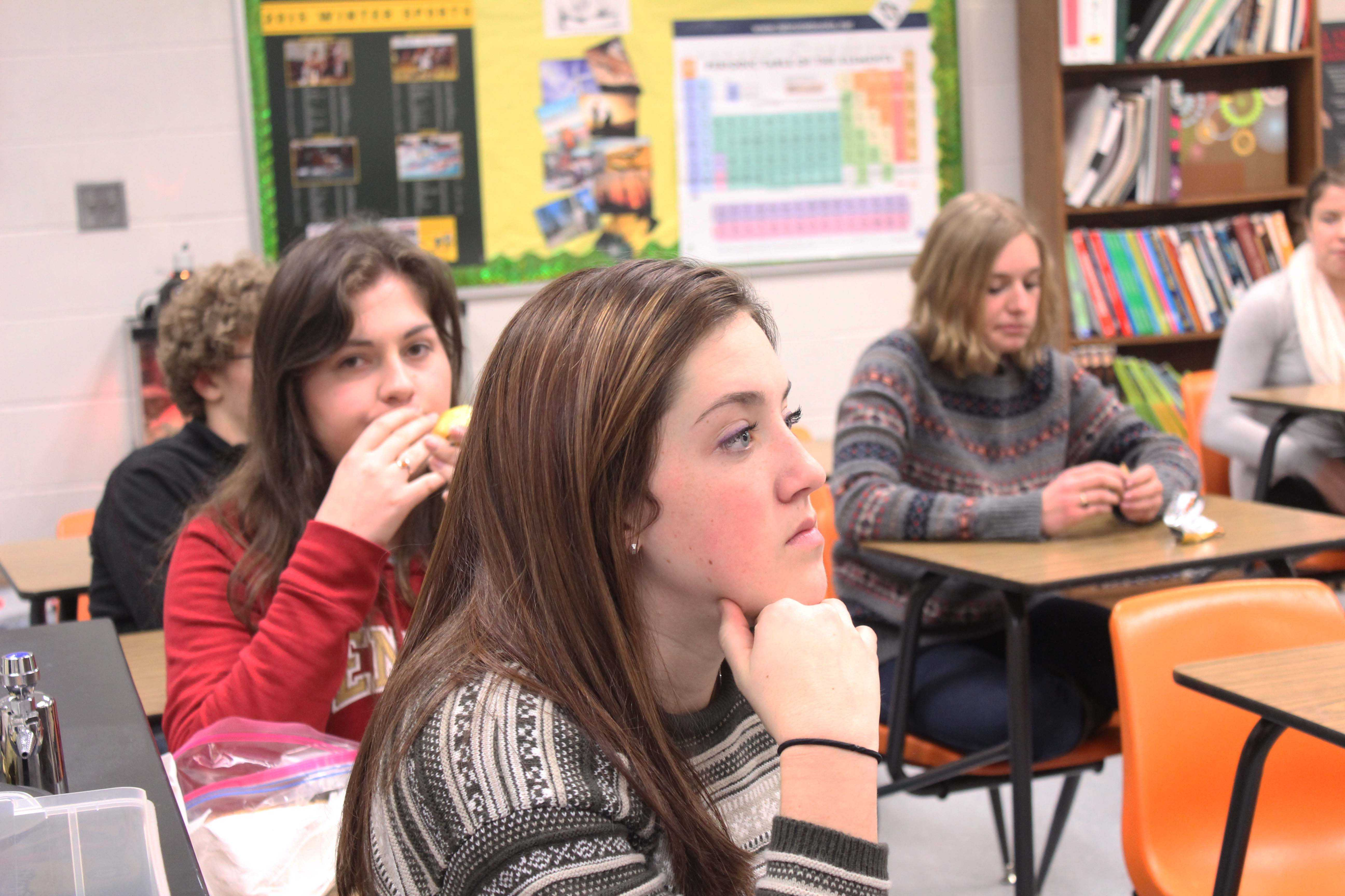 Maddie Dyer (12) listens to Mrs. Roberson brief the members of National Honors Society (NHS) for the annual NHS Babysitting Night. This night has been a tradition within the society for years, this night usually takes place during the second semester.
