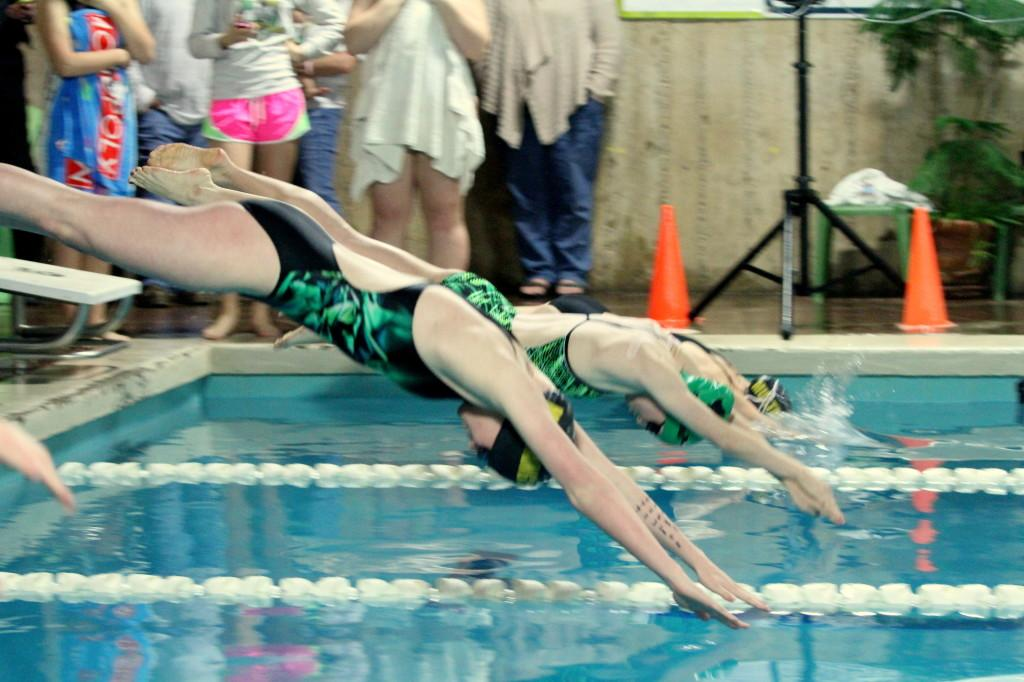 Photo by Maggie Santos. Veronica Morin starts her leg of a relay.