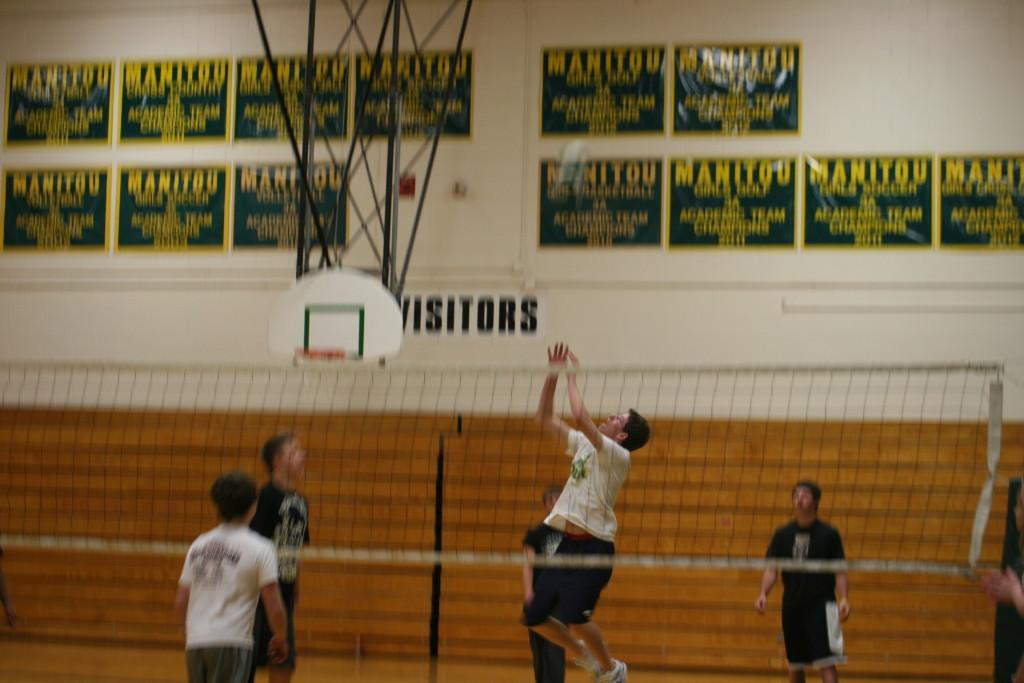 Senior Jason Cox jumps for the ball. Photo by Renae Musekamp