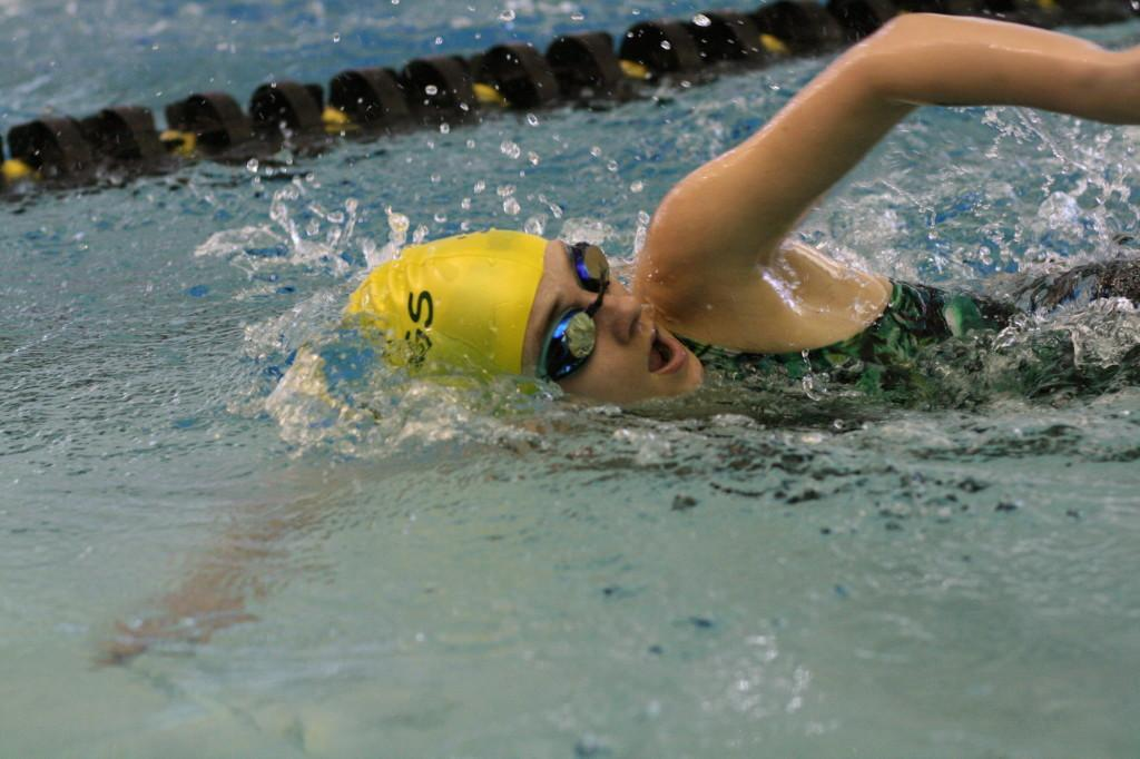 Photo+by+Julia+Vance.%0ASenior+Margaret+Barton+competing+in+the+200+freestyle+relay.