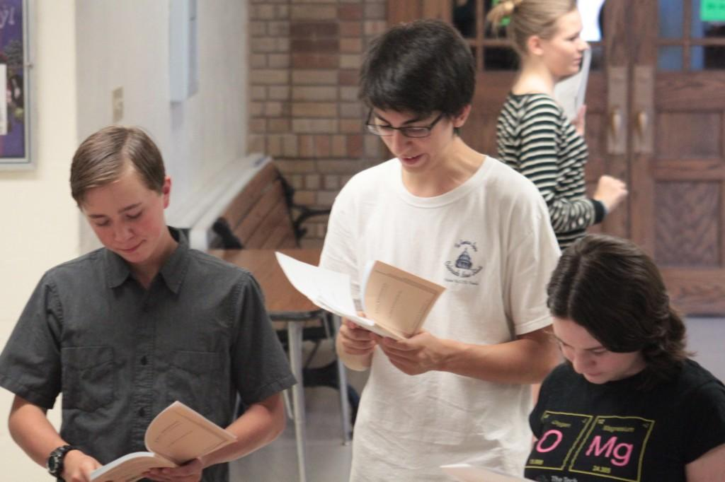 Senior Patrick Ortiz (Center) and Sophmore Morgan Baker (Left) review their monologues Photo by Nichole Delany