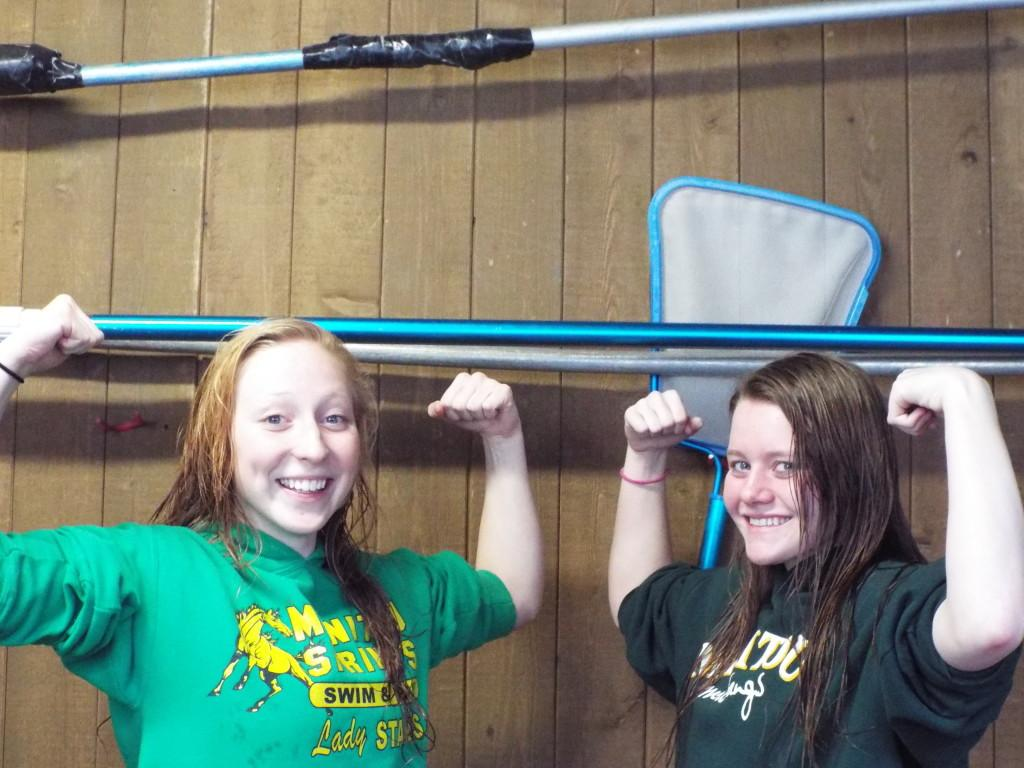 Sammatha White (10), Vronica Morin (10) show off their guns before the state qualifying relay.