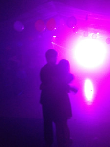 """Couples dance in the serious moonlight. Snowcoming week ended with """"A Night in the Stars"""" or a space themed dance, complete with fog machines and blacklights."""