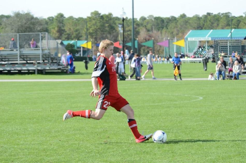 Sawyer Lincoln shoots the ball in a club soccer game.