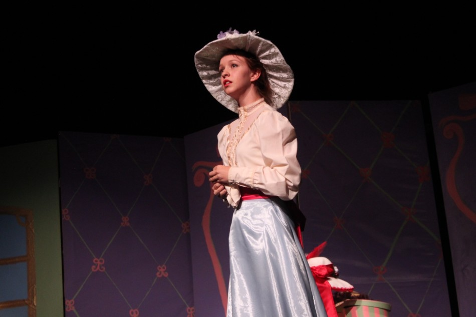Irene Molloy (Isabel Dufford) sings with passion about her want for a husband. Irene wants a husband, but does not love Horace Vandergelder. She declares that she will wear an elaborate hat to impress a gentleman (
