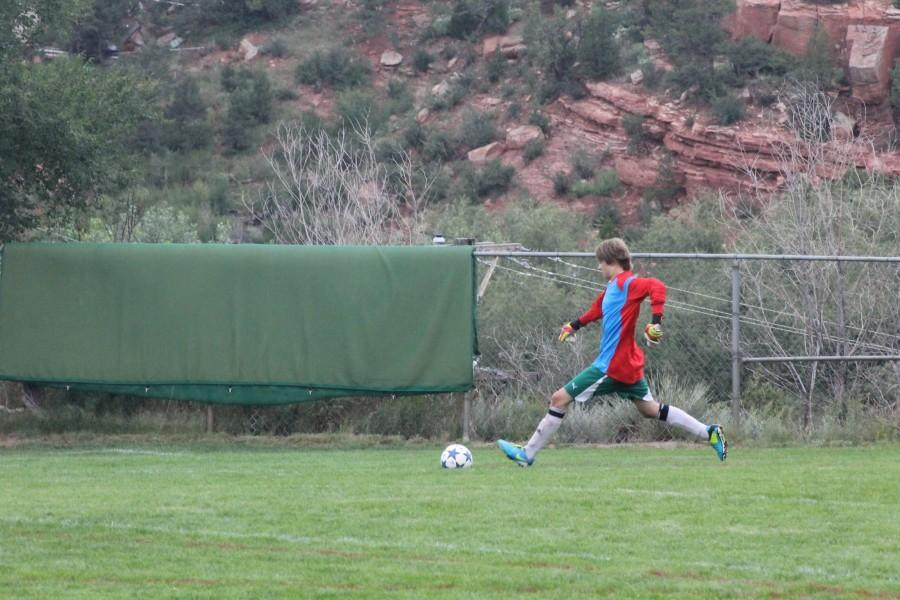 JV goalie, Devin Szajner (9), takes a goal kick to help his team up the field.
