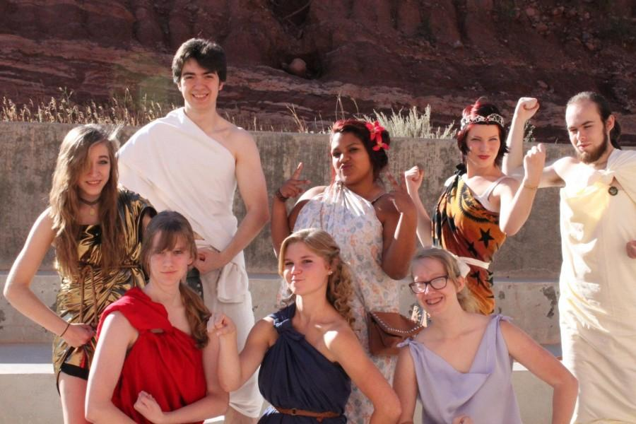 (From left to right) Madison Robinson (12), Severn Belmond (12), Rachael Bradshaw (12), Naomi Bauer (12), Maria Hernandez (12), Ellorah Simmons (12), Hunter Adcock (12), and Spencer Aurand (12), dress up for senior toga day.