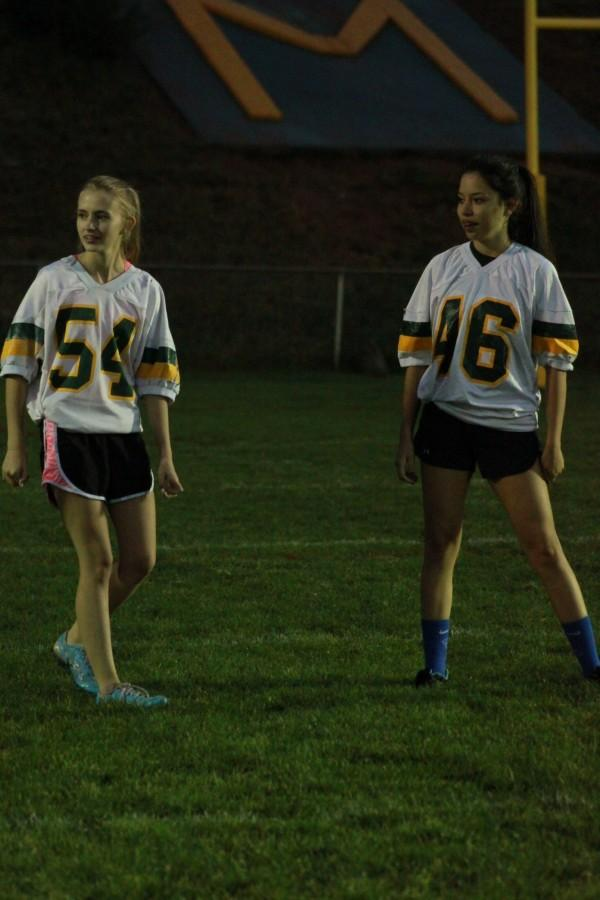 Seniors Diana Blake and Misty Kerze anxiously wait to be put in to play.