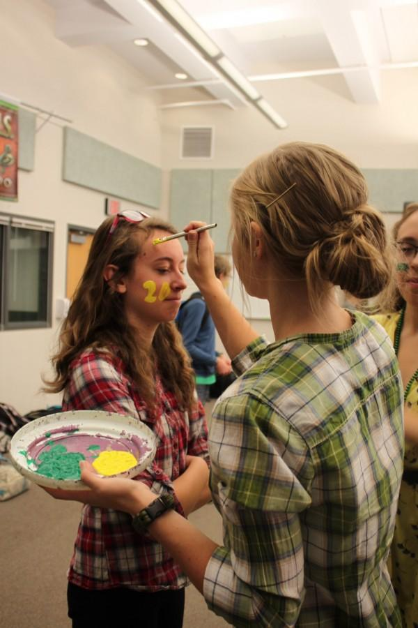 Naomi Bauer (12) paints up Sarah Bogush (9) in tradition of the senior froshings.