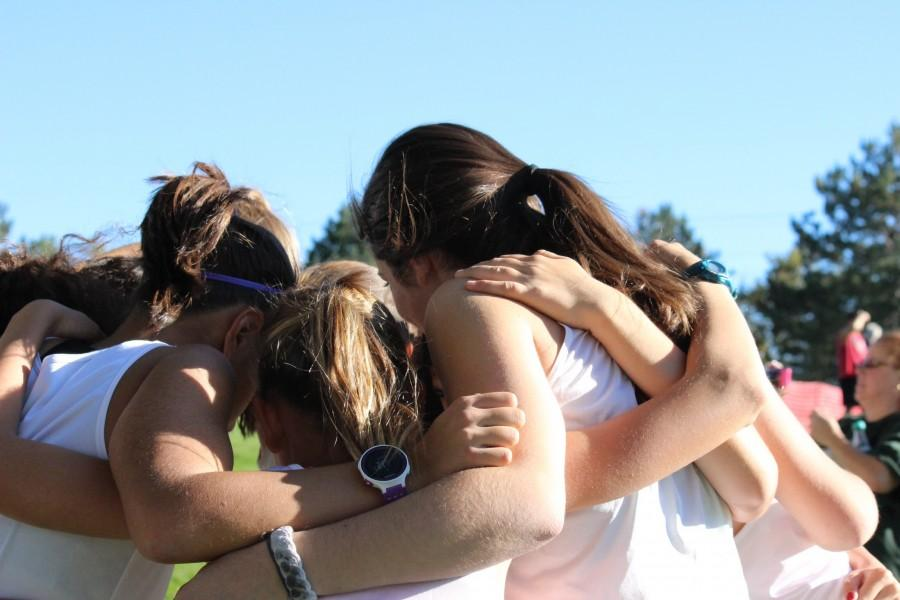 Before they run the course the girls huddle up.