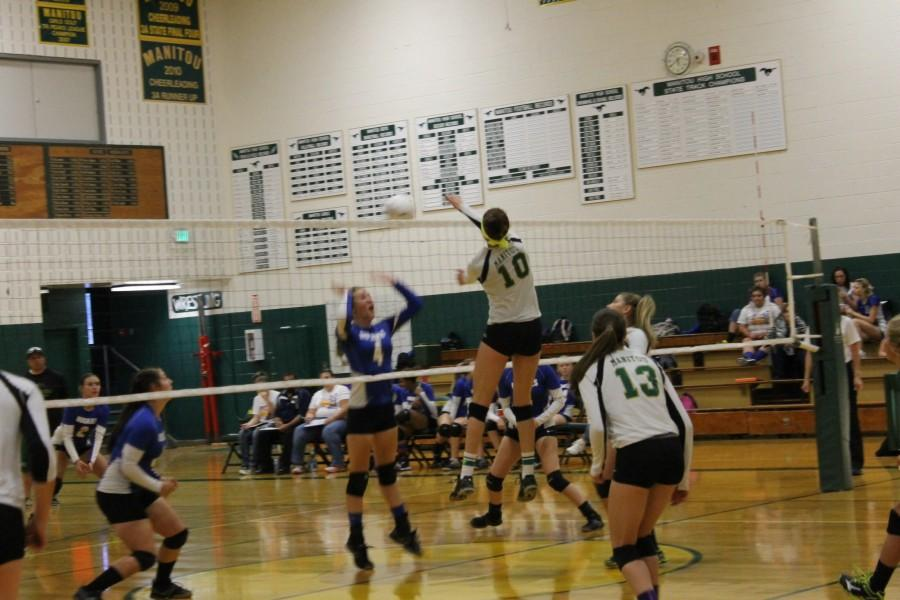 Brooke Garretson (#10) jumps high in the air to score another point for the mustangs