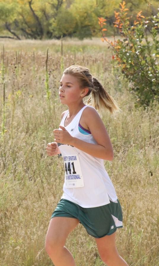 Kaitlyn Davidson (9) races towards the finish line.
