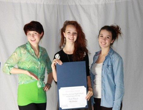 Left to right: Editor-in-Chief of the Warhorse Hunter Adcock (12), Editor-in-Chief of the Prospector Isabel Dufford (12), and Head Photography Editor Daisy Erickson (12) hold the third-place Best of Show placard awarded to Manitou on Thursday, October 9.