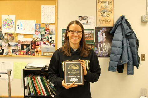 Mrs. Roberson holding her coach of the year award.