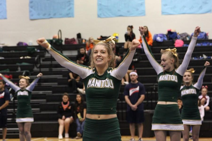 Kelsey Hartwig and Kaylin Cole stick high-Vs.