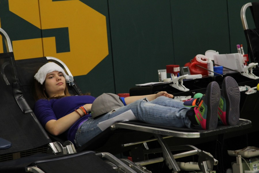 Rebecca Alford (11) relaxes while calmly giving blood.