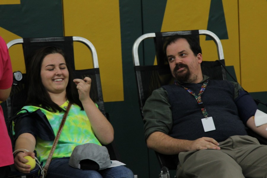 Sophia Ives (11) and high school English teacher, Timothy Hilt, ease each other's nerves while giving blood.