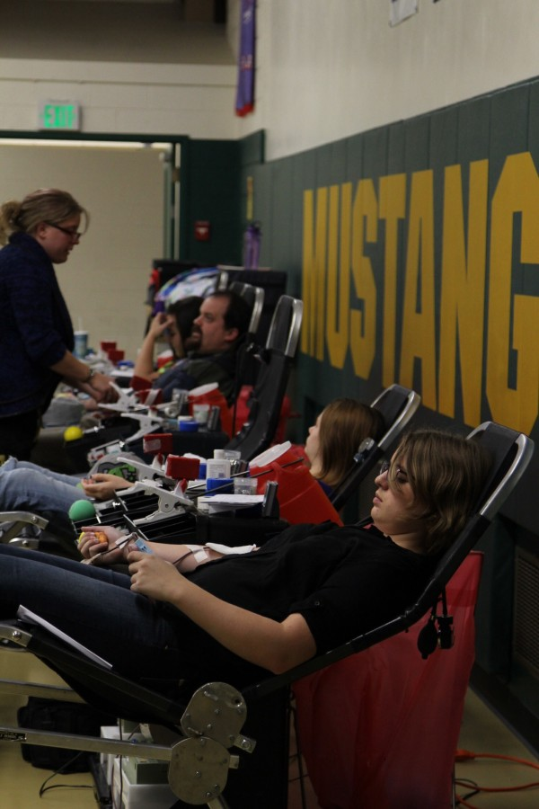 Students and teachers generously donate blood that could potentially save lives.
