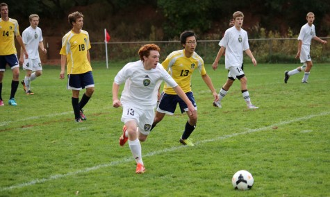 Captain Leland Spangler dribbles the ball against CSCS