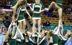 Susie Robbins (12), Kendahl Bent (12), and Alyssa Prince (10) complete their pyramid.