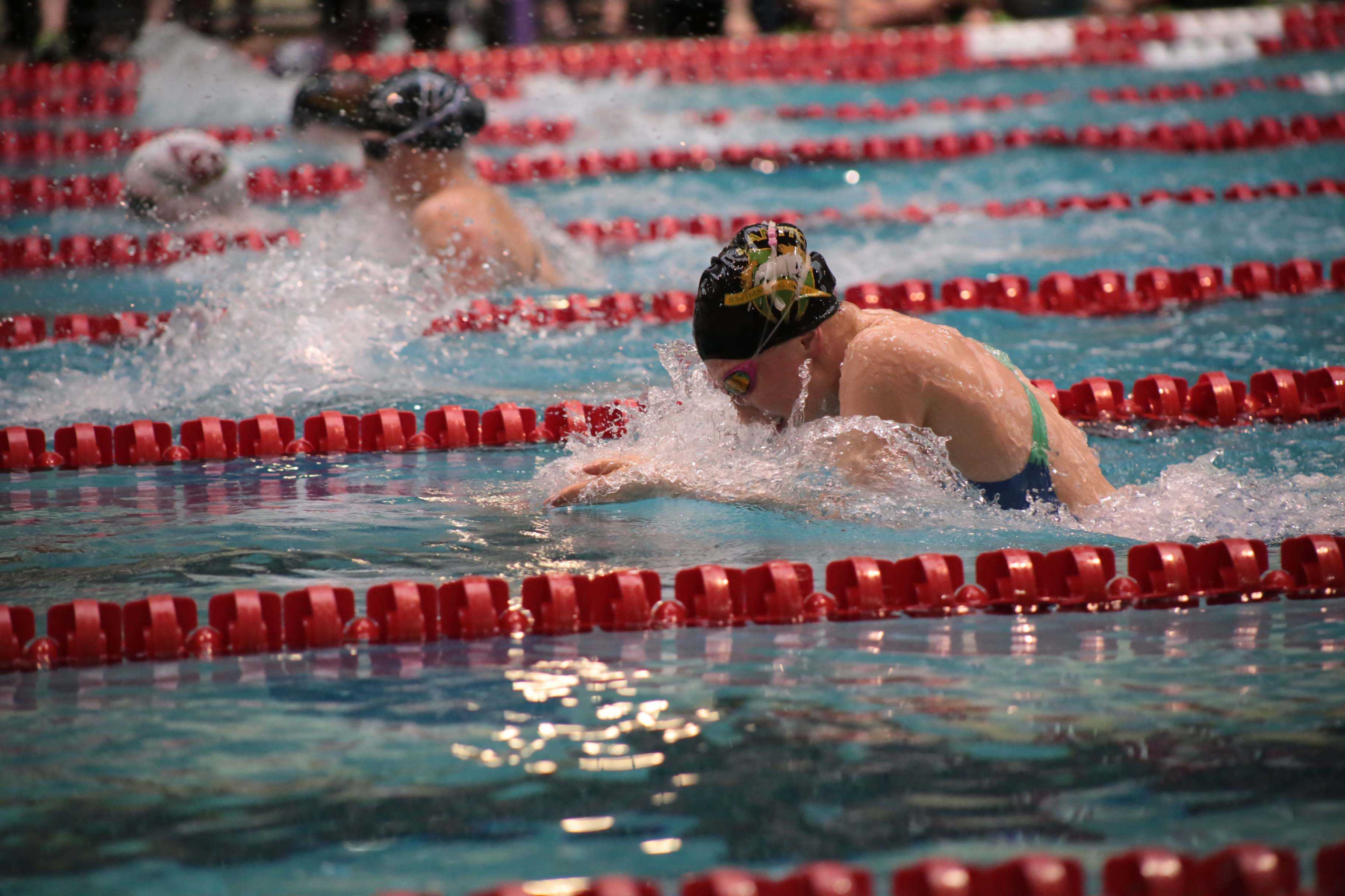 Sam White competes in the record-breaking 200 Medley Relay during the 2014 season.