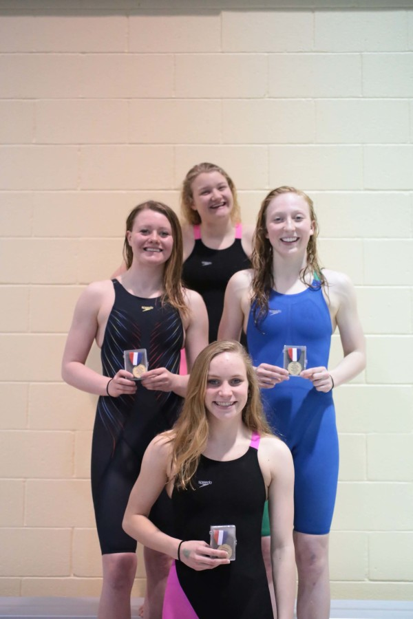 Emily Dolloff-Holt, Veronica Morin, Sam White, and Kethrys Buffa show off their first place medals at the the CHSAA State Swimming Championships.