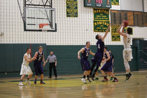 Lucas Rodholm goes for three while Danny McGee helps guard.