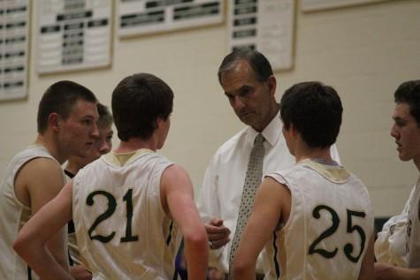 Ryan Adamscheck and his fellow teammates listen intently to their coach, BLANK Vecchio