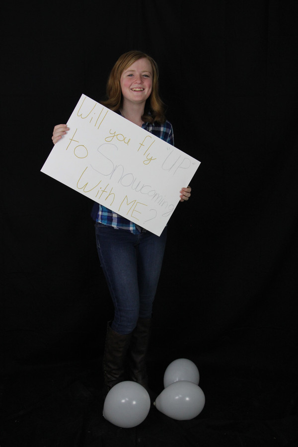 Katelinn surprised Jorrey with a poster and balloons. The sign reads,