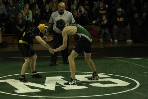 Heart beating quickly with the adrenaline of the moment, Wyatt Vanderheyden claps hands with his Woodland Park opponent, watching him with bitter resentment.