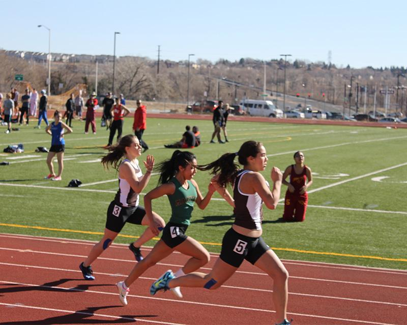 Susie Robbins, 12, runs the 100m dash at the Harrison track meet.