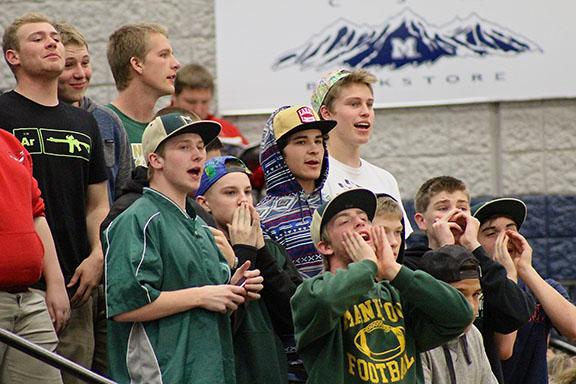 Billy Ryan (12), Drew Mendoza (12) Darwin Fredrickson (12) Andy Thompson (12) cheer on the girls during the Final Four of the state championship.