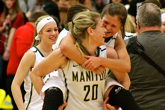Kassidee Palmer (10) and Angala Jensen (11) cannot contain their excitement after a tense, close game against Eaton. The entire game, neither team had more than a four point lead, and Manitou pulled ahead in the last few seconds of the game.