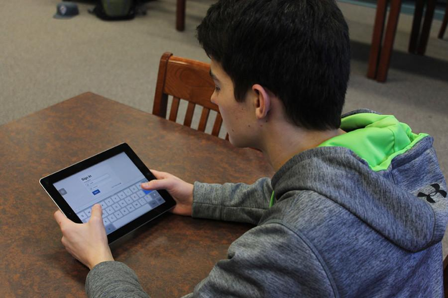 A student at Manitou Springs High School takes the PARCC test on his iPad.