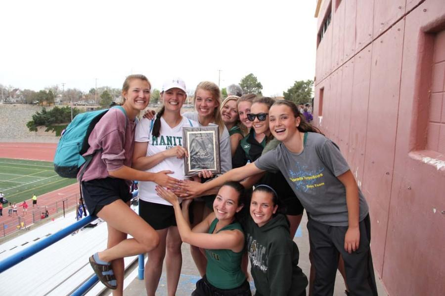 The Manitou girls track team celebrates their big win at the John Tate Invitational track meet on Saturday, April 11.