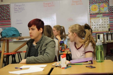 Brennan McLaren (10) and Rebekah Shaw (12) listen to an on-the-fly motion about the dress code in Student Council. Recently, the council has decided to look at re-writing the dress code to make it more reasonable and accepting for all genders.