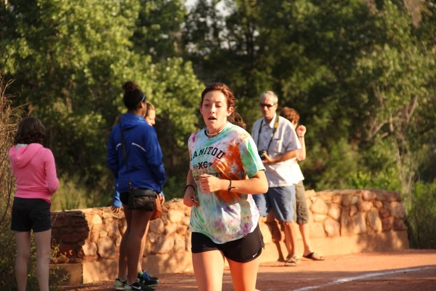 Maddie Dyer (12) competes in the Doherty Never Alone Scrimmage 5k. This race took place in Monument Valley Park before school began. Though it was an early race, the girls' Cross Country team all finished relatively close together.