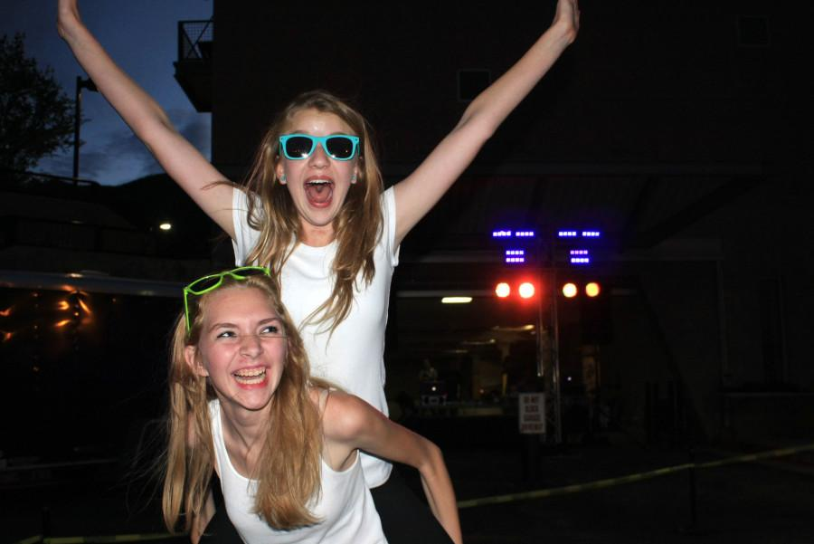 Bailey Vicher-Nickerson (11) and MAddie Butts (10) celebrate their spirit at the Color Dance. Both are members of STUCCO and helped set up for the dance.