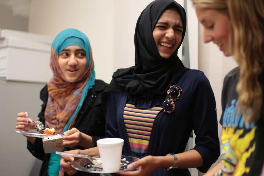 Asma Rassema (12), Shamsa Sajid (10) and Katy Grieb (11) socialize during a campaign for Kindness event.