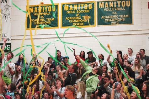 The senior class shows their school pride by throwing green and gold streamers. The goal was for the senior class to show the most spirit.