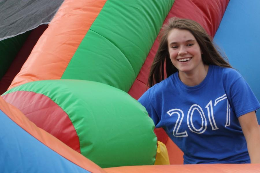 Olivia Doherty (11) experiences the Bouncy Slide at the Carnival.
