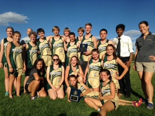 The MSHS cross country team poses with the 2nd plaques they recieved.