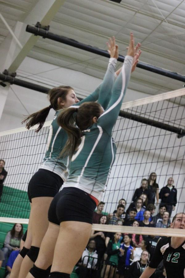Angala Jensen (12) ans Brooke Garretson work together to score on the other team.