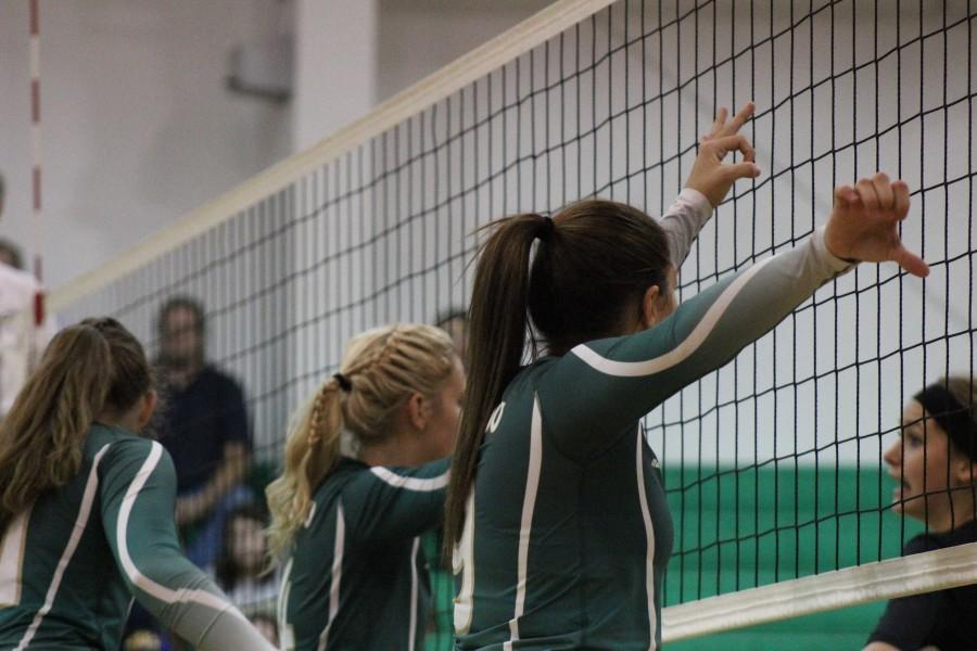Angala Jensen (12) along with teammate, Kaitlann Brown, prepare for the game to begin. The crowd sits in suspense.