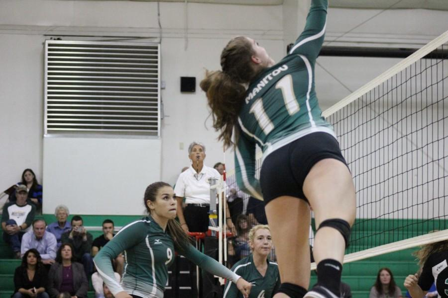 Angala Jensen (12) attempts to help her teammate Katie Mckiel (12). Everyone who came cheers them on.