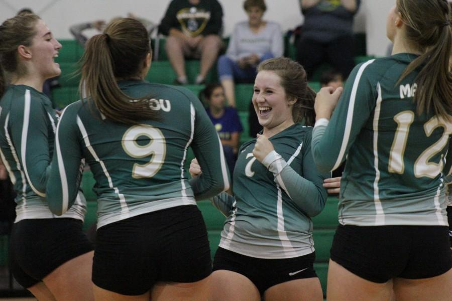 Caroline Ruyle (12) celebrates as Manitou is in the lead. The crowd cheers them on.