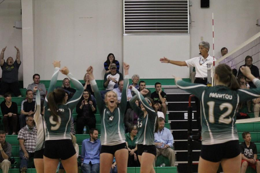 Kaitlann Brown (12) cheers for manitou as the team just scored. The rest of Manitou Varsity is just as excited.