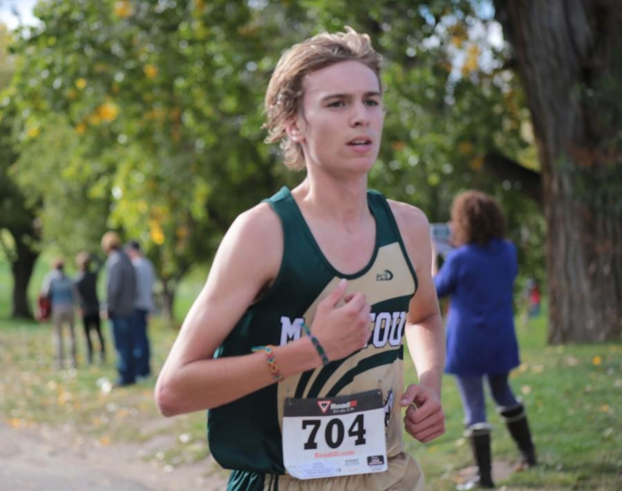 Seth Nolen (11) runs in the middle of his second mile during the race.