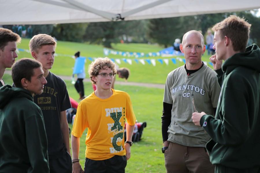 Boys' Cross Country coach Duane Roberson gives a post-race speech