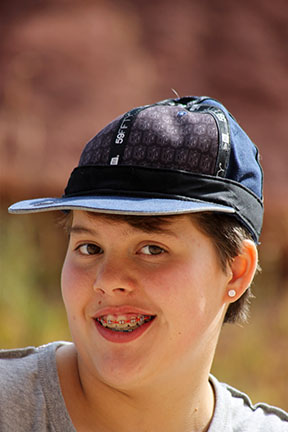Carina Villarreal (11) flips her beloved New England Patriots hat unsure out to show her school spirit.